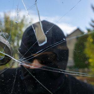 1602779567burglar-breaking-window