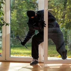 intruder-coming-in-thru-glass-doors-900x625