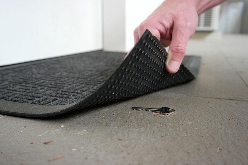 key under a door mat