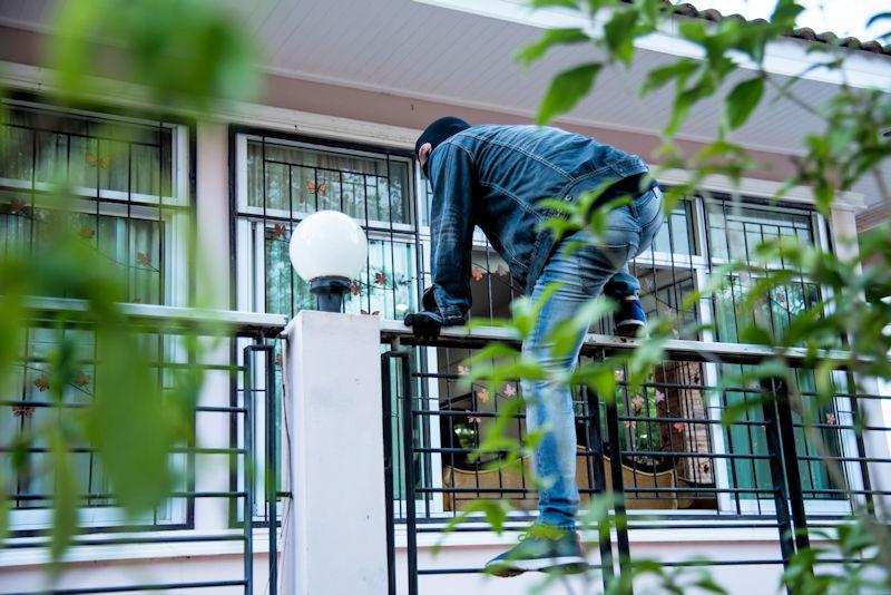 burglar climbing onto blacony